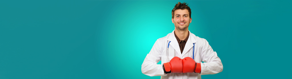 Doctor Wearing Boxing Gloves Isolated On Blue Background